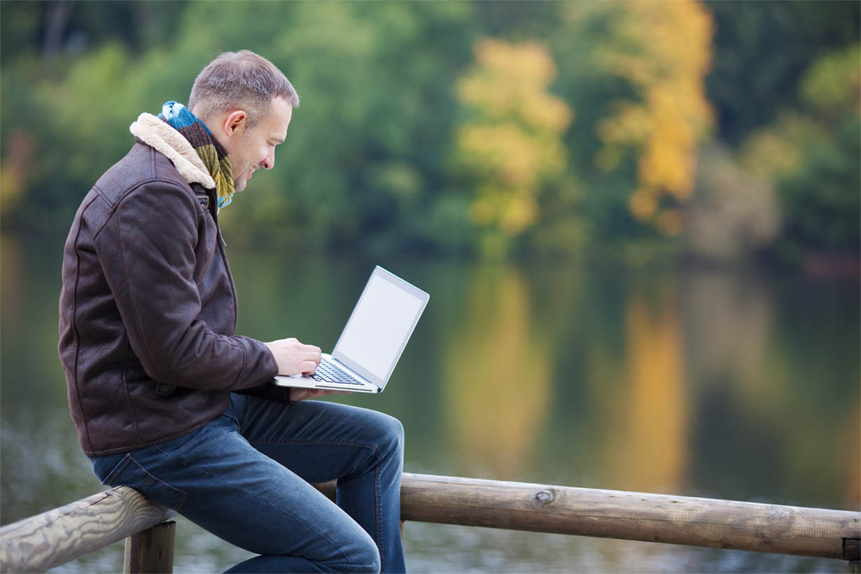 Business Man Working Outdoors in Natural Surroundings